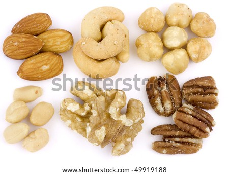 Roasted and salted mixed nuts on white background
