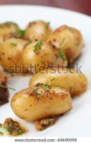 Roasted baby potatoes with onion, mustard seed and chives