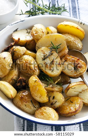Roasted baby potatoes with rosemary, in a vintage enamel serving bowl.