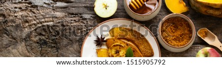 Roasted, baked pumpkin with apples, slices and mint. Healthy food concept with copy space. Copy space. Rustic natural style banner. Thanksgiving banner concept.