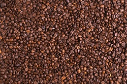 Roasted black coffee beans background. Top view, backdrop