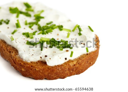 Roasted bread with cream cheese and chives, isolated on white