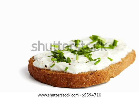 Roasted bread with curd / cream cheese and chives, isolated on white