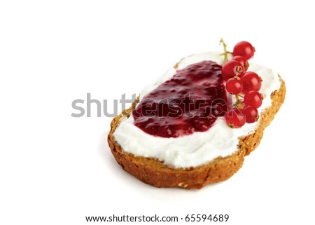 Roasted bread with jam / marmelade garnished with red currants