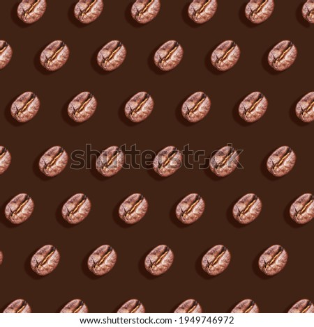 Roasted brown coffee beans pattern on brown background with hard shadow. Taste energy brown morning beverage. Horizontal banner Photo stock ©