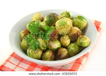 roasted brussels sprouts on white background - stock photo