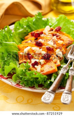 Roasted butternut squash salad with cheese,nut and cranberry