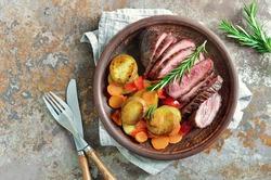 Roasted carrots, potato and cut meat, plain rustic dish