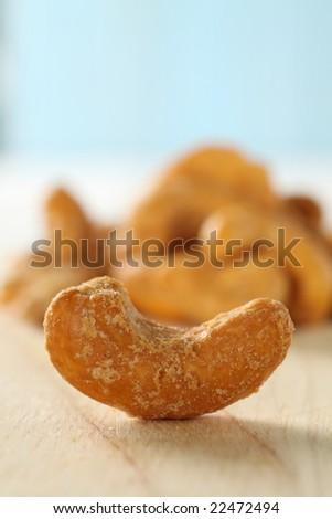 roasted cashew nut isolated on wooden background.