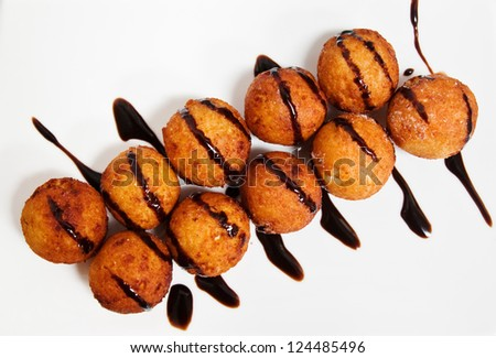 Roasted cheese balls deep fried poured chocolate