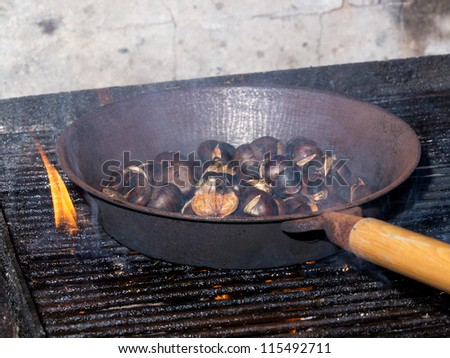roasted chestnuts in the fireplace