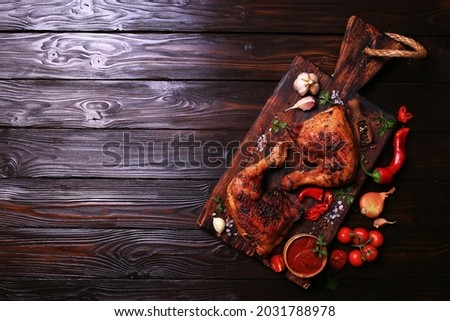 Roasted chicken legs with spices and vegetables Stock fotó ©