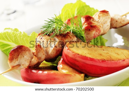 Roasted chicken skewer and baked apple