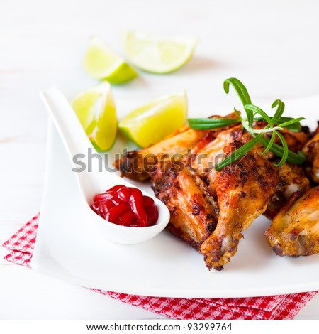 Roasted chicken wings with rosemary and lime