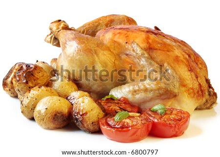 Roasted chicken with baby roast potatoes and roasted tomatoes.