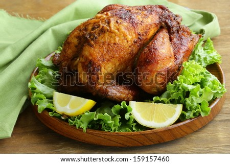 roasted chicken with herbs served on a plate with lemon