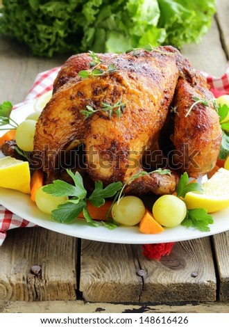 roasted chicken with herbs served on a plate with vegetables and grapes