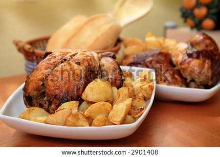 roasted chicken with potato on white bowl ready for eat
