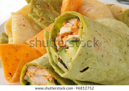 Roasted chicken wrapped in vegetable tortilla shells with chips