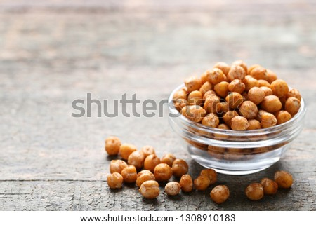 Roasted chickpeas in bowl on grey wooden table #1308910183