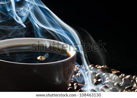 Roasted coffee and cup