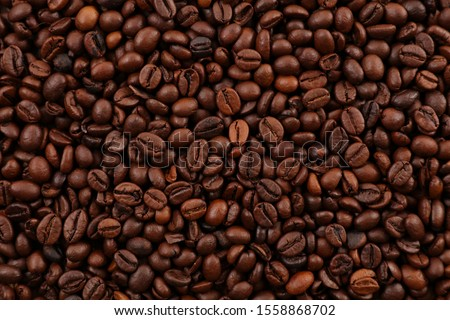 roasted coffee bean background, top view