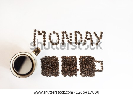Roasted Coffee Beans background texture isolated on white background with copy space for text. Monday writing top view, battery and a mug