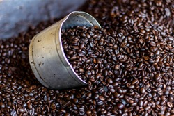 Roasted coffee beans. Concept of agribusiness and production