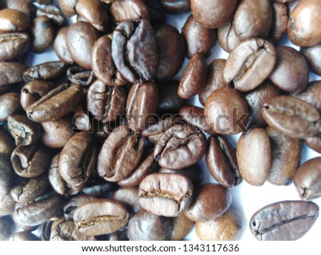Roasted coffee beans, dark brown and light brown on a white background #1343117636