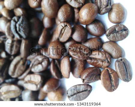 Roasted coffee beans, dark brown and light brown on a white background #1343119364