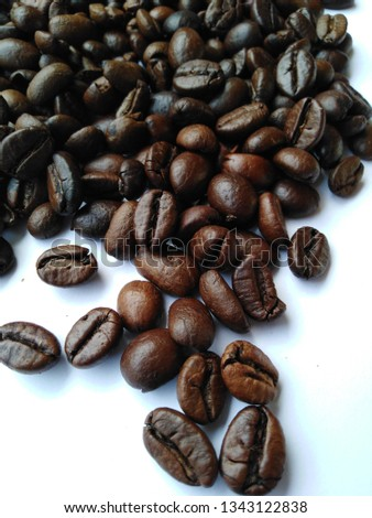 Roasted coffee beans, dark brown and light brown on a white background #1343122838