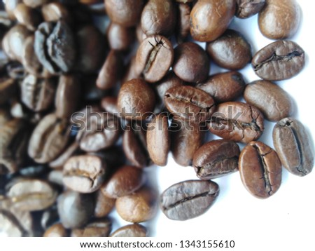 Roasted coffee beans, dark brown and light brown on a white background #1343155610