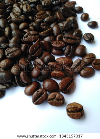 Roasted coffee beans, dark brown and light brown on a white background #1343157017