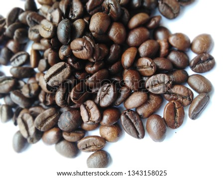 Roasted coffee beans, dark brown and light brown on a white background #1343158025