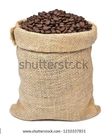 Roasted coffee beans falling in a burlap sack. Sackcloth bag with coffee beans, isolated on white background. Coffee export.