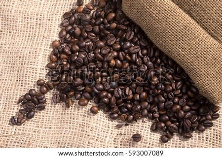 Roasted coffee beans in a bag on a table #593007089