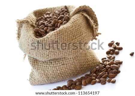 roasted coffee beans in a bag on a white background