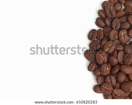 Photo of Roasted coffee beans  isolated on white background.(with free space for text)