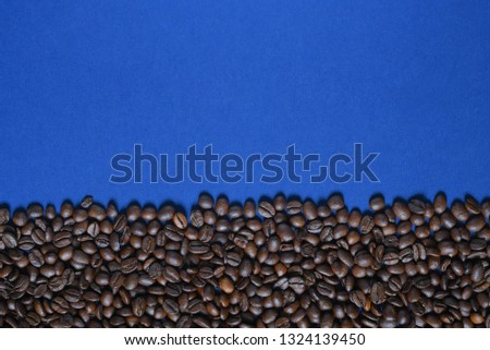 Roasted coffee beans on a blue background