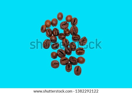 roasted coffee beans on blue background