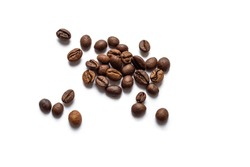 Roasted coffee beans scattered on white background