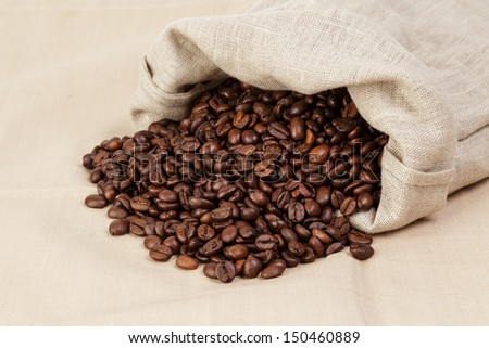 roasted coffee beans spill out of the bag, textile #150460889