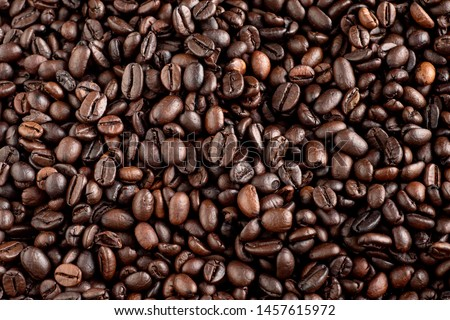 Roasted coffee beans with background.