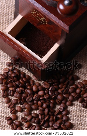 Roasted coffee beans with wooden Coffee grinder
