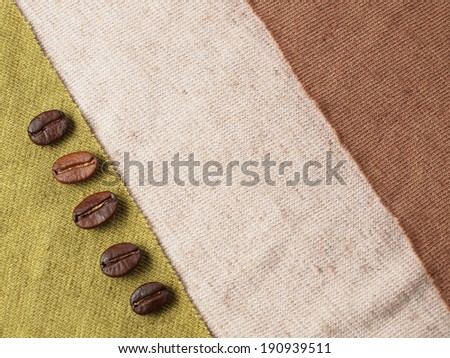 Roasted Coffee Crop Beans on fabric textile