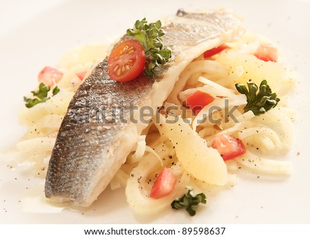 Roasted fish sea bass fillet with fennel, tomato and lemon salad