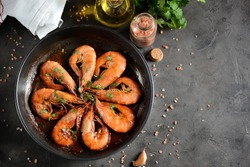 Roasted (fried) big shrimps in tomato sauce with olive oil, garlic, cilantro and soy sauce...