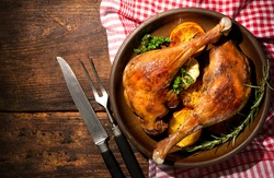 Roasted goose legs with oranges and spices. Cooking at Christmas time
