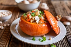 Roasted Hokkaido pumpkin stuffed with chickpeas, quinoa, mushrooms and pepper