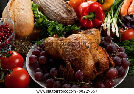 Roasted holiday turkey garnished with sourdough stuffing and fruit